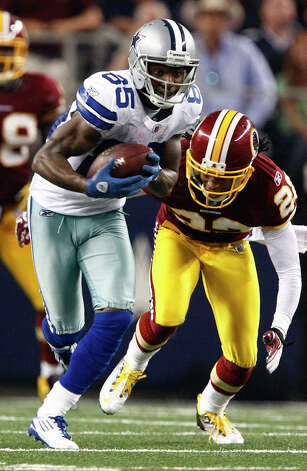 Dallas Cowboys wide receiver Kevin Ogletree (85) get a first down under pressure from Washington Redskins defensive back Kevin Barnes (22) during the second half of an NFL football game Monday, Sept. 26, 2011, in Arlington. Photo: Jose Yau, AP Photo/Waco Tribune Herald, Jose Yau / Waco Tribune Herald 2011