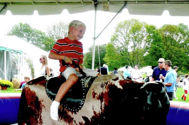 Matteo Santulin gets ready to challenge the mechanical bull at Go Wild! Ride 'em, cowboy!!! Photo: Anne W. Semmes