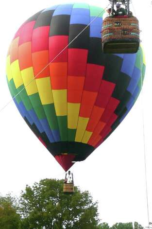 Two hot air balloons lift up in tandem at Go Wild! with passengers rising up 75 feet above the ground on the tethered 100-foot-high balloons. Photo: Anne W. Semmes
