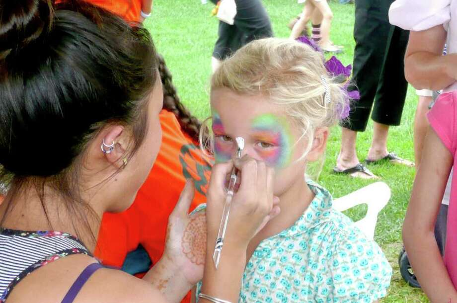 Olivia Pol manages to stay very still as she is transformed into a butterfly at Go Wild! Photo: Anne W. Semmes