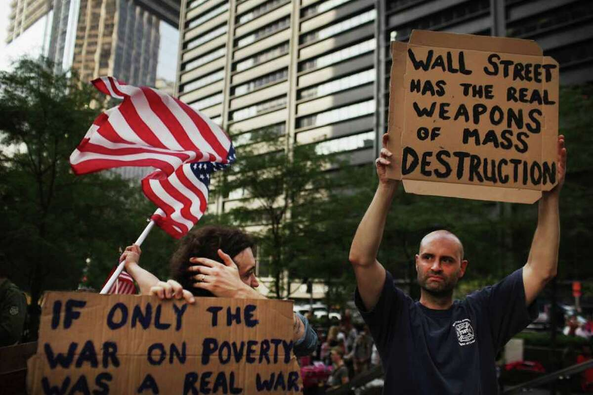 Demonstrators opposed to corporate profits on Wall Street march in the Financial District on September 26, 2011 New York City. Hundreds of activists affiliated with the