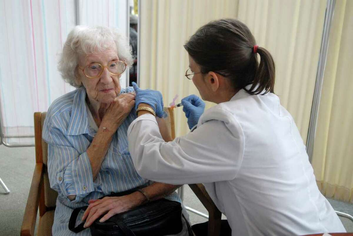 Thelma Carey (95) gets her flu shot from Sandra Morano at the Government center in Stamford, Conn. on Tuesday September 27, 2011 sponsored by the city and Stamford Hospital.