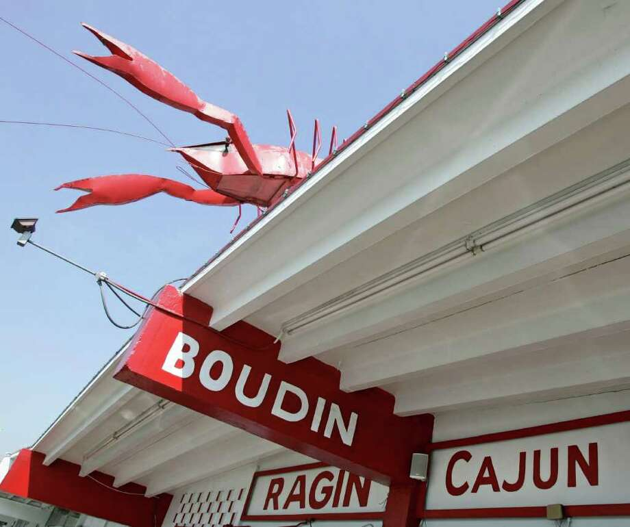 In case you don't know, the RAGIN' Cajun restaurant sells crawfish. You can tell by the gigantic ugly mud bug on top.  Photo: CRAIG H. HARTLEY, FOR THE CHRONICLE / FREELANCE