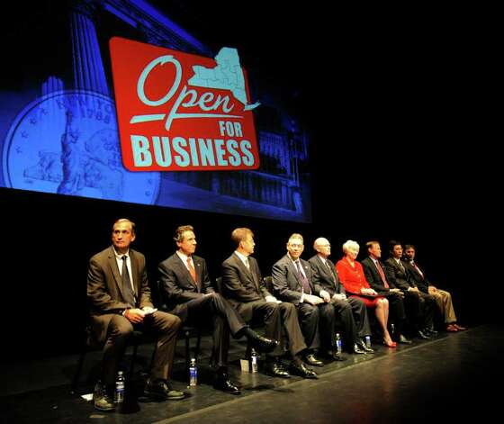 Gov. Andrew Cuomo, second from left, is joined by business leaders as he addresses the assembly in the Hart Theatre in Albany, N.Y., to announce a business initiative encompassing the design and production of a new nano chips in New York state on Sept. 27, 2011.  (Skip Dickstein / Times Union) Photo: SKIP DICKSTEIN / 2011