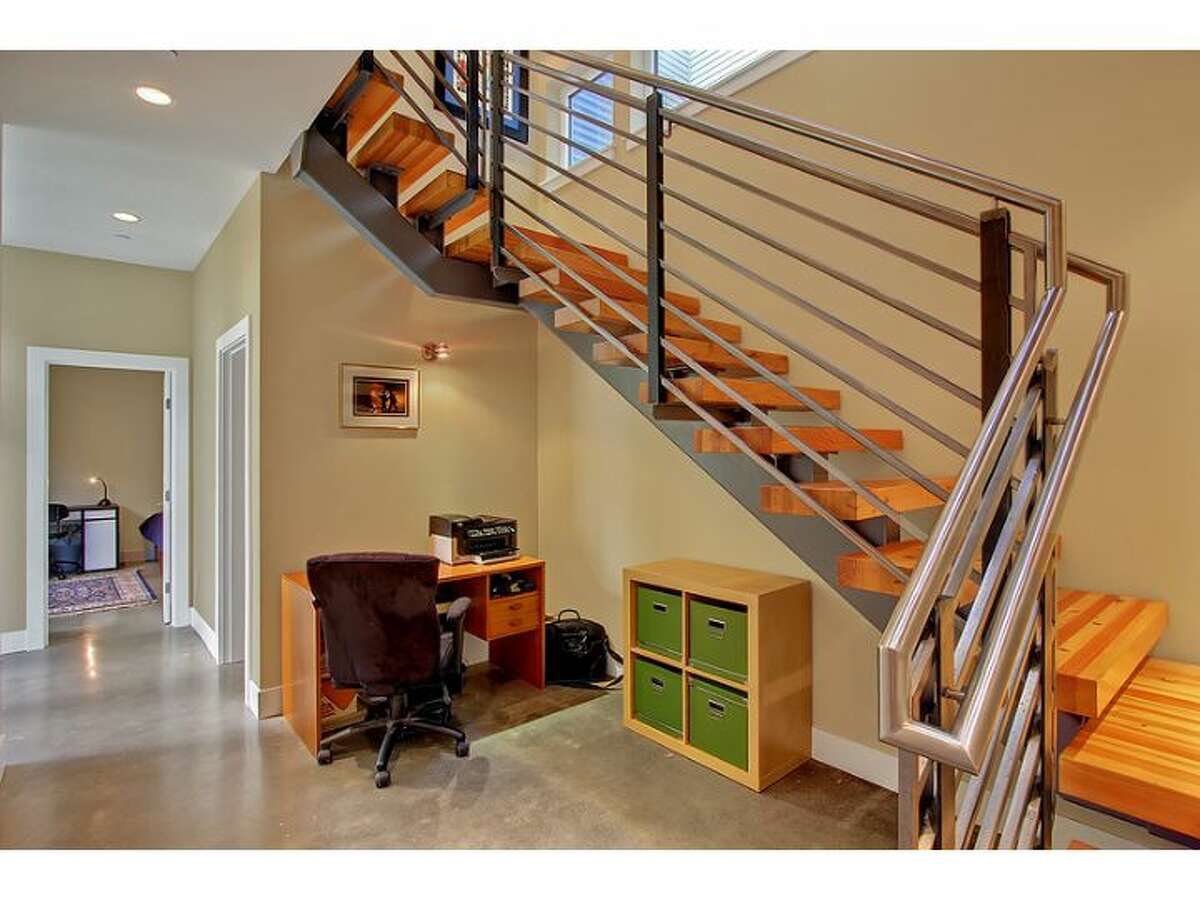 'Floating' staircase of 1514 Alki Ave. S.W. The 3,530-square-foot house, built in 2009, includes four bedrooms, three bathrooms, an elevator, covered deck with a stainless-steel gas fireplace and a penthouse deck. It sits on a 3,120-square-foot lot and is listed for $1.85 million.