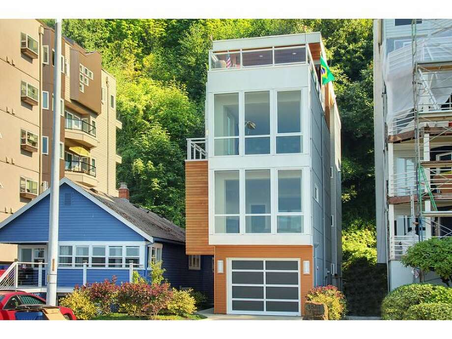 West Seattle seems to be a haven for contemporary architecture. Here are three such homes there priced over $1 million, starting with this four-story house at 1514 Alki Ave. S.W.. The 3,530-square-foot house, built in 2009, includes four bedrooms, three bathrooms, an elevator, 'floating' staircase, covered deck with a stainless-steel gas fireplace and a penthouse deck. It sits on a 3,120-square-foot lot and is listed for $1.85 million. Photo: Windermere Real Estate