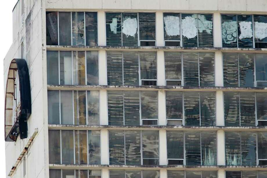Graffiti windows and chipped paint is all that's left of the old Days Inn on 801 St. Joseph Parkway.  Photo: Mayra Beltran, Houston Chronicle / © 2011 Houston Chronicle