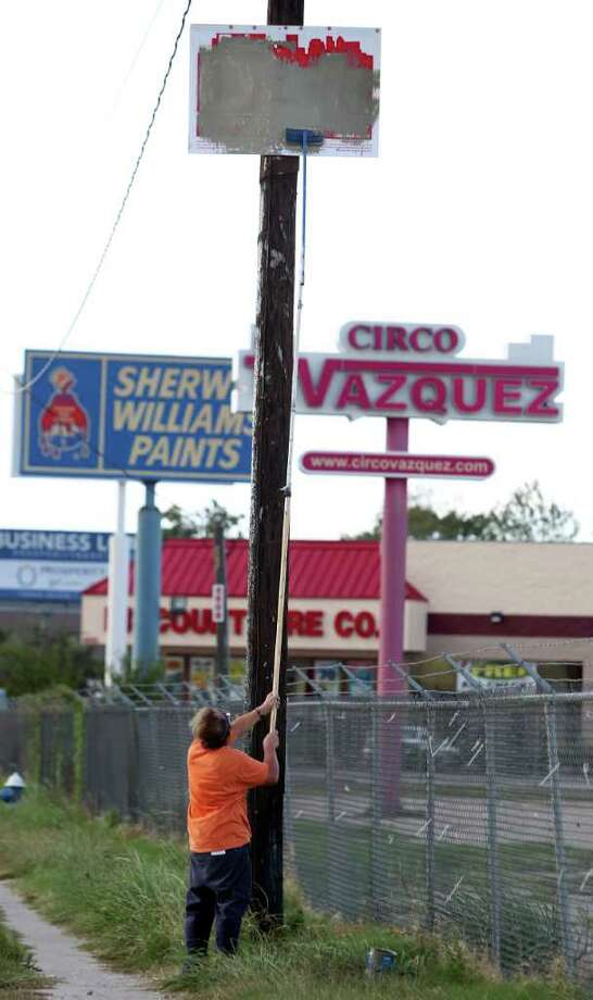 The feeder road along I-45 has some of the ugliest signs around. And that's saying a lot.  Photo: Mayra Beltran, Houston Chronicle / © 2011 Houston Chronicle