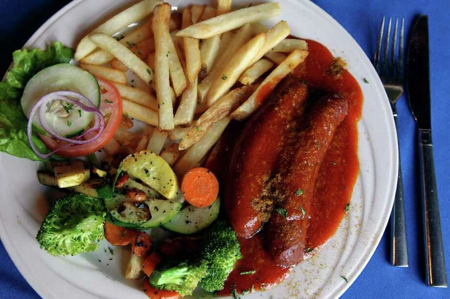 Currywurst, a German street food staple, traces its history to the time just after the end of World War II. Photo: TOM REEL, SAN ANTONIO EXPRESS-NEWS / © 2011 San Antonio Express-News