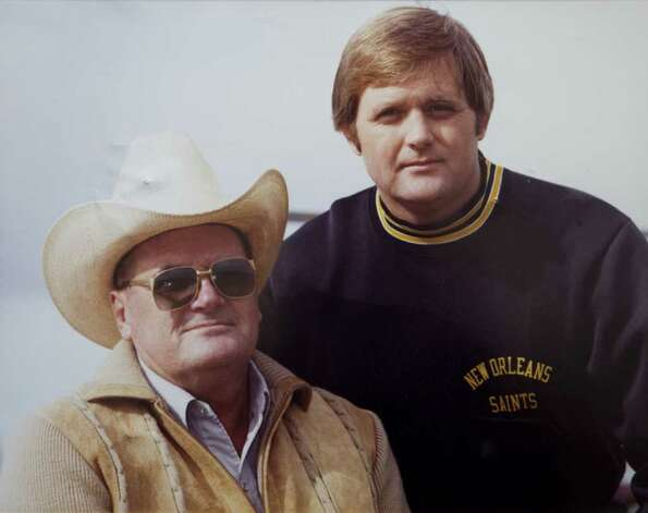 "Former Houston Oilers head coach O.A. ""Bum"" Phillips is shown with his son, Dallas Cowboys head coach Wade Phillips in a 1981 photo that hangs on the wall at his ranch copied Tuesday, Sept. 21, 2010, in Goliad. ( Phillips Family Photo ) Photo: Coomer, Brett, HO / Beaumont"