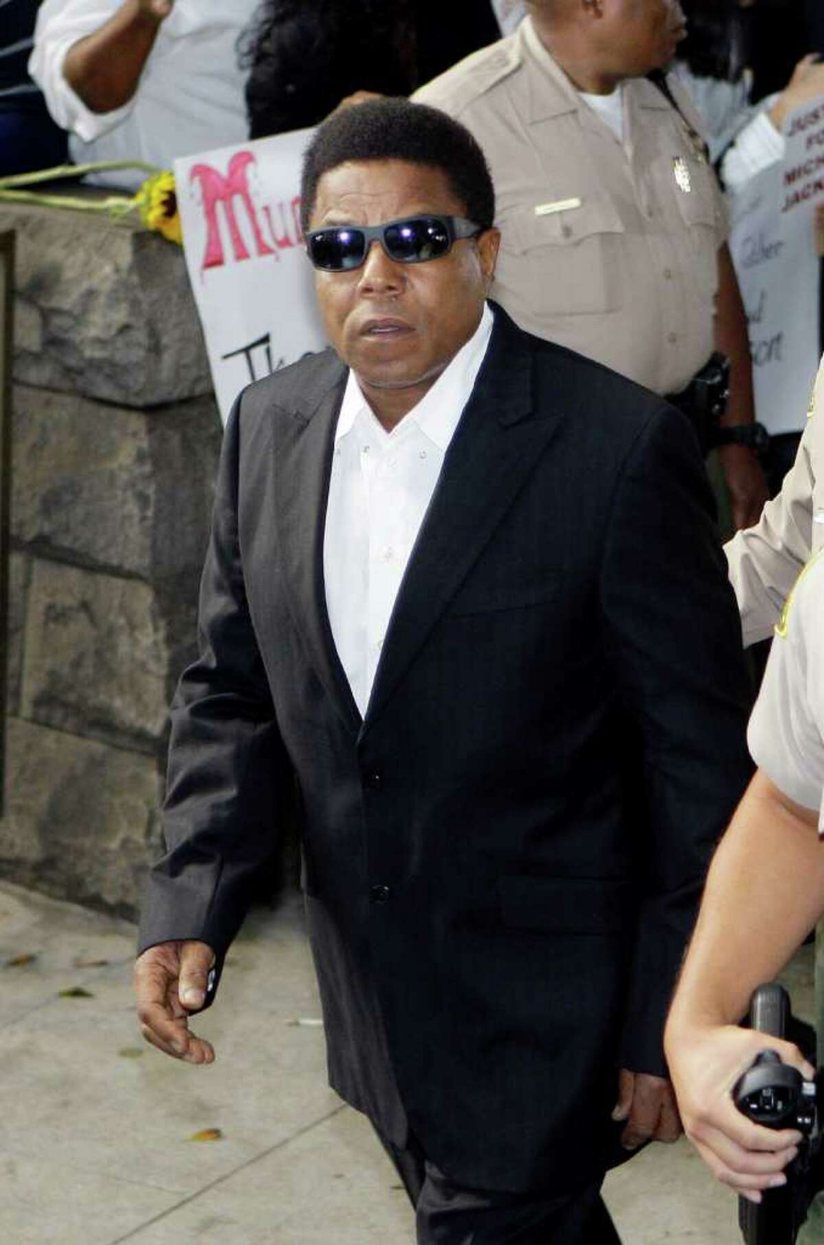Michael Jackson's brother Tito Jackson arrives as the involuntary manslaughter trial for Dr. Conrad Murray, Jackson's personal physician when the pop star died, gets underway at the Criminal Justice Center in Los Angeles Tuesday, Sept. 27, 2011. Murray has pleaded not guilty and faces four years in prison and the loss of his medical license if convicted of involuntary manslaughter. (AP Photo/Reed Saxon)