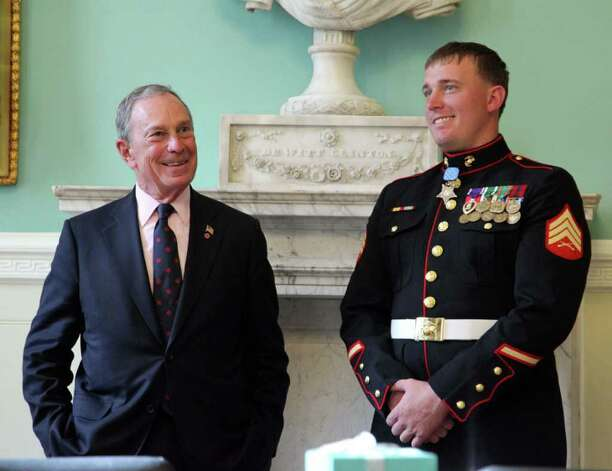 "FILE- In this Sept. 19, 2010 file photo, New York Mayor Michael Bloomberg, left, shares a laugh with Congressional Medal of Honor recipient former Marine Sgt. Dakota Meyer of Greensburg, Ky., at City Hall, in New York. Meyer is refusing to apply to the New York City Fire Department after a federal judge denied his request to reopen the application period for all aspiring firefighters. The judge agreed Monday to a 24-hour extension for Sgt. Dakota Meyer to submit an application — but only to accommodate him. Meyer's lawyer says he doesn't want to be a ""one-person exception"" to the deadline and won't apply.  (AP Photo/New York City Mayor's Office, Edward Reed, File) Photo: Edward Reed"