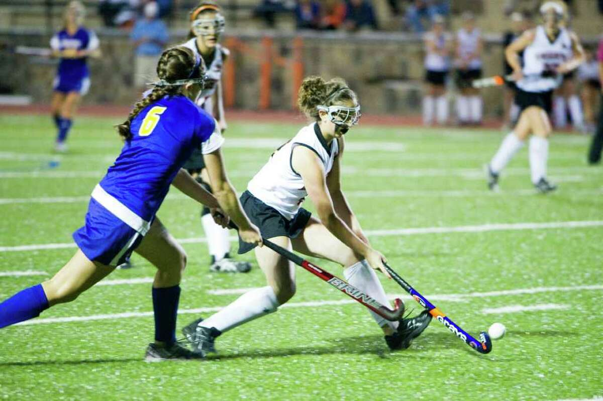 Stamford's Nicole Lorenti, right, and Westhill's Sylvie Josel in action as Stamford High School hosts Westhill in a field hockey game in Stamford, Conn., Sept. 27, 2011.