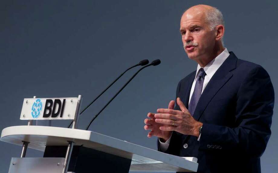 Greek Prime Minister Georgios Papandreou delivers his speech at the annual conference of the Federation of German Industry (BDI) in Berlin, central Germany, Tuesday, Sept. 27, 2011.  Papandreou will meet German Chancellor Angela Merkel later in the evening. (AP Photo/Markus Schreiber) Photo: Markus Schreiber / AP