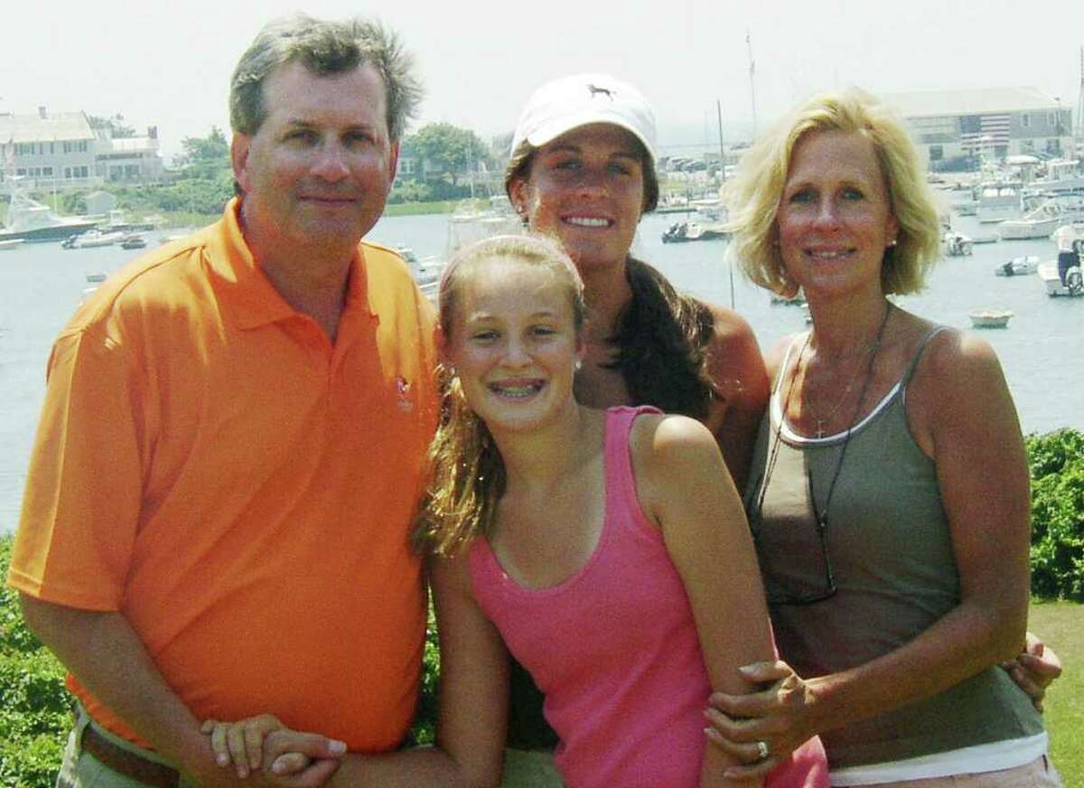 FILE - This June 2007 file photo provided by Dr. William Petit Jr., shows Dr. Petit, left, with his daughters Michaela, front, Hayley, center rear, and his wife, Jennifer Hawke-Petit, on Cape Cod, Mass. Dr. Petit was severely beaten and his wife and two daughters were killed during a home invasion in Cheshire, Conn., July 23, 2007. A trial for Joshua Komisarjevsky, the second of two men charged with the crimes, begins Monday, Sept. 19, 2011, in New Haven, Conn., Superior Court. (AP Photo/William Petit, File)