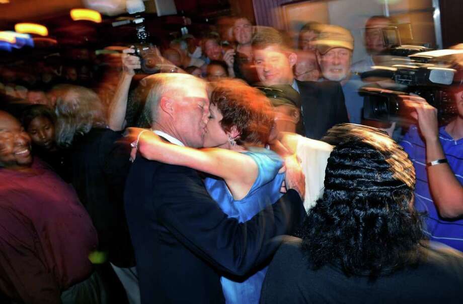 Mayor Bill Finch kisses his wife Sonya as they celebrate after the primary election at Tiago's Bar & Grill in downtown Bridgeport, Conn. on Tuesday September 27, 2011. Photo: Christian Abraham / Connecticut Post