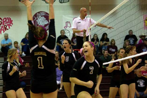Magnolia's Kylie Randall (5) celebrates a point with her teammates as Magnolia defeated Waller 3-0 at Magnolia High School Tuesday, Sept. 27, 2011, in Houston.  Randall scored her 1,000 kill during the game. Photo: Johnny Hanson, Houston Chronicle / © 2011 Houston Chronicle