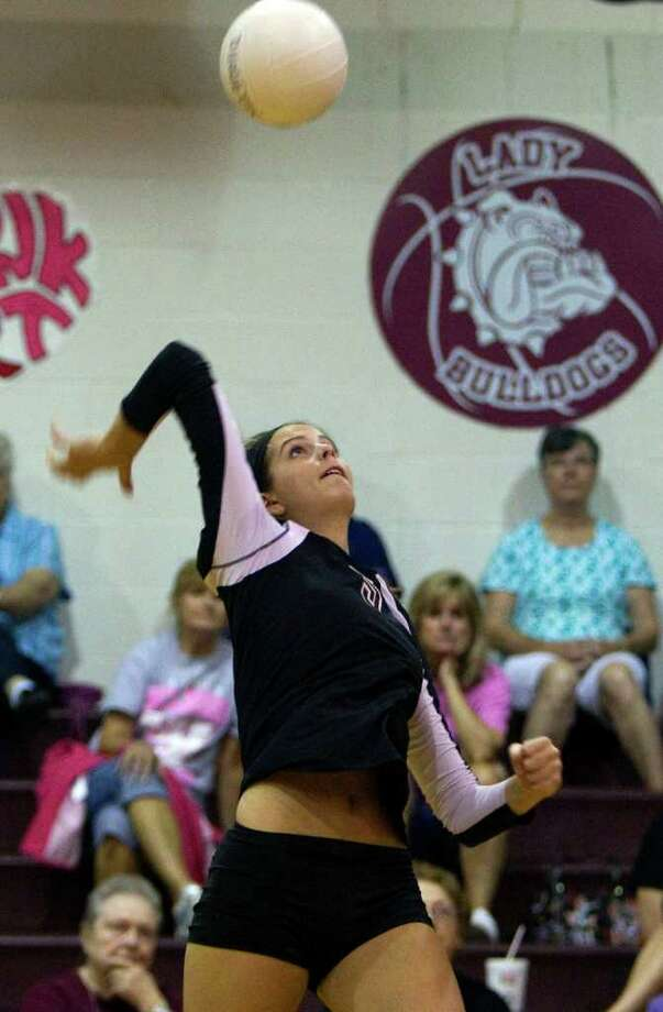Magnolia's Kylie Randall (5) prepares to spike the ball as Magnolia defeated Waller 3-0 at Magnolia High School Tuesday, Sept. 27, 2011, in Houston.  Randall scored her 1,000 kill during the game. Photo: Johnny Hanson, Houston Chronicle / © 2011 Houston Chronicle