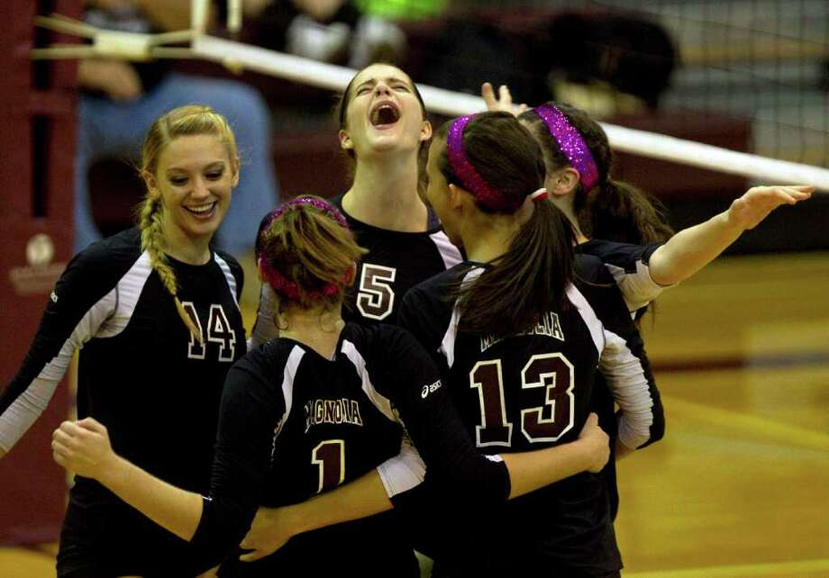 Magnolia's Kylie Randall (5) celebrates a point with her teammates. Photo: Johnny Hanson, Houston Chronicle / © 2011 Houston Chronicle