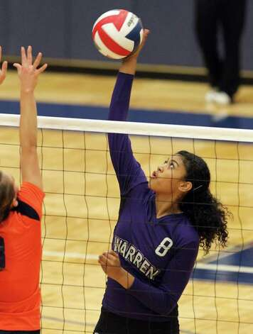 Warren's Leilani Lealiamatafao (08) attempts a kill against Brandeis during their match at Paul Taylor Fieldhouse on Tuesday, Sept. 27, 2011. Kin Man Hui/kmhui@express-news.net Photo: Kin Man Hui, -- / San Antonio Express-News