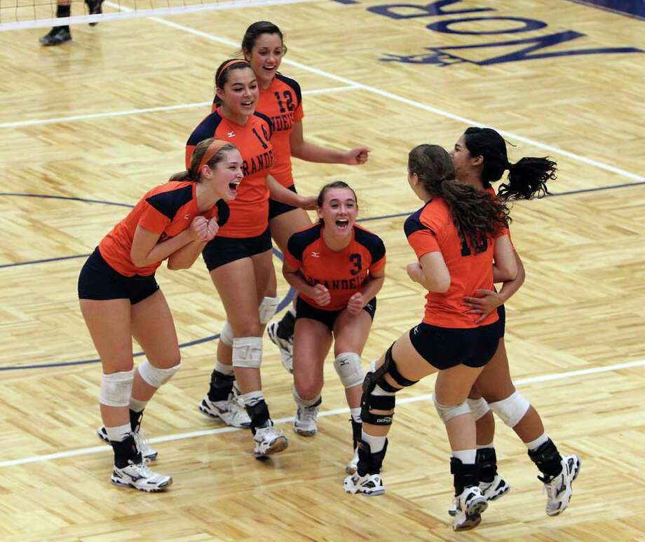 The Brandeis volleyball team reacts after taking the fourth game against Warren during their match at Paul Taylor Fieldhouse on Tuesday, Sept. 27, 2011. Kin Man Hui/kmhui@express-news.net Photo: Kin Man Hui, -- / San Antonio Express-News