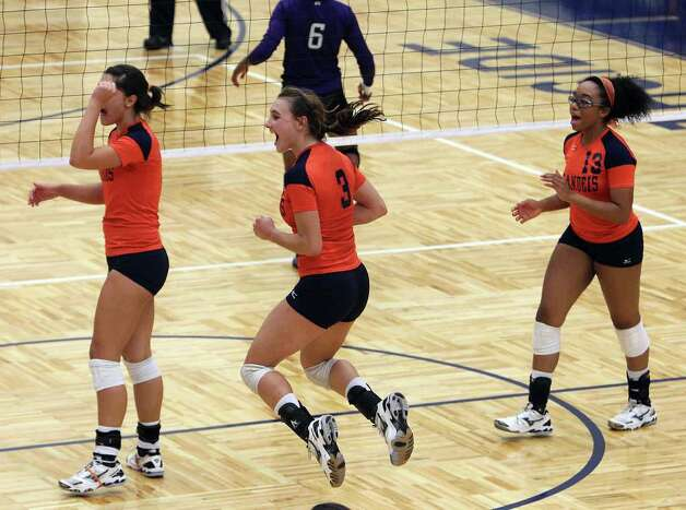 Brandeis' Marissa Banda (03) leaps into the air after a score against Warren during their match at Paul Taylor Fieldhouse on Tuesday, Sept. 27, 2011. Kin Man Hui/kmhui@express-news.net Photo: Kin Man Hui, -- / San Antonio Express-News