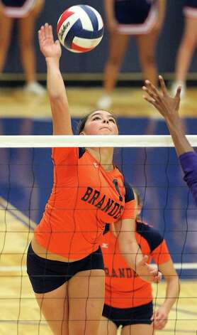 Brandeis' Analise Cardenas (14) goes for a shot against Warren during their match at Paul Taylor Fieldhouse on Tuesday, Sept. 27, 2011. Kin Man Hui/kmhui@express-news.net Photo: Kin Man Hui, -- / San Antonio Express-News