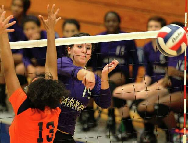 Warren's Shaina Garza (15) hits past Brandeis' Taylor Mastin (13) during their match at Paul Taylor Fieldhouse on Tuesday, Sept. 27, 2011. Kin Man Hui/kmhui@express-news.net Photo: Kin Man Hui, -- / San Antonio Express-News