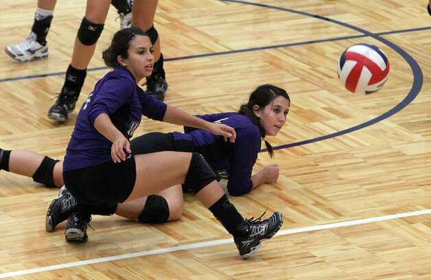 Warren's Victoria Denis Gonzalez (front) and Shaina Garza (back) tumble to the ground as a Brandeis shot gets past them during their match at Paul Taylor Fieldhouse on Tuesday, Sept. 27, 2011. Kin Man Hui/kmhui@express-news.net Photo: Kin Man Hui, -- / San Antonio Express-News