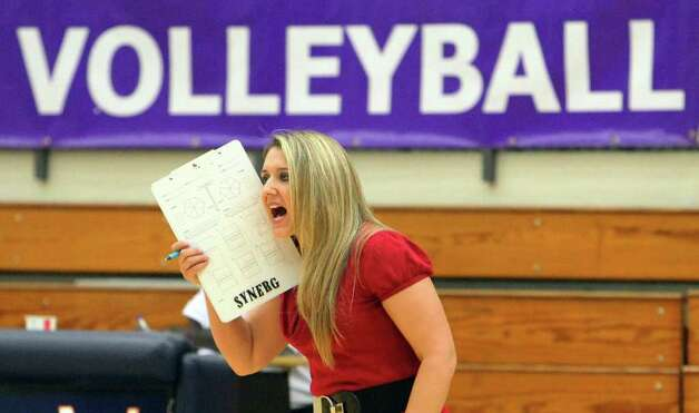 Warren volleyball coach Brandace Cantu urges her team against Brandeis during their match at Paul Taylor Fieldhouse on Tuesday, Sept. 27, 2011. Kin Man Hui/kmhui@express-news.net Photo: Kin Man Hui, -- / San Antonio Express-News