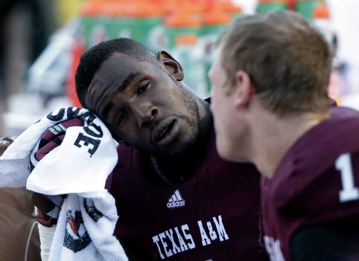 WILTING: The heat was on receiver Jeff Fuller, left, and quarterback Ryan Tannehill in the fourth quarter as A&M found itself trying to mount a comeback after leading 20-3 at halftime.