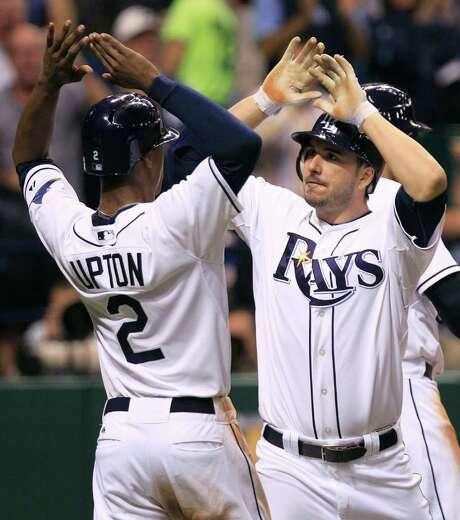 CHRIS O'MEARA: ASSOCIATED PRESS RAY OF HOPE: Tampa Bay's Matt Joyce, right, had plenty to celebrate with teammate B.J. Upton after Joyce's three-run homer. Photo: Chris O'Meara / AP