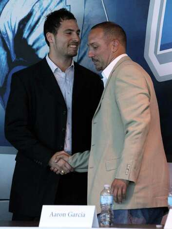 Former Holmes and Baylor receiver Robert Quiroga (left) greets ArenaBowl champion quarterback Aaron Garcia during a press conference Tuesday, Sept. 27, 2011 at the Alamodome. Photo: John Davenport/jdavenport@express-news.net