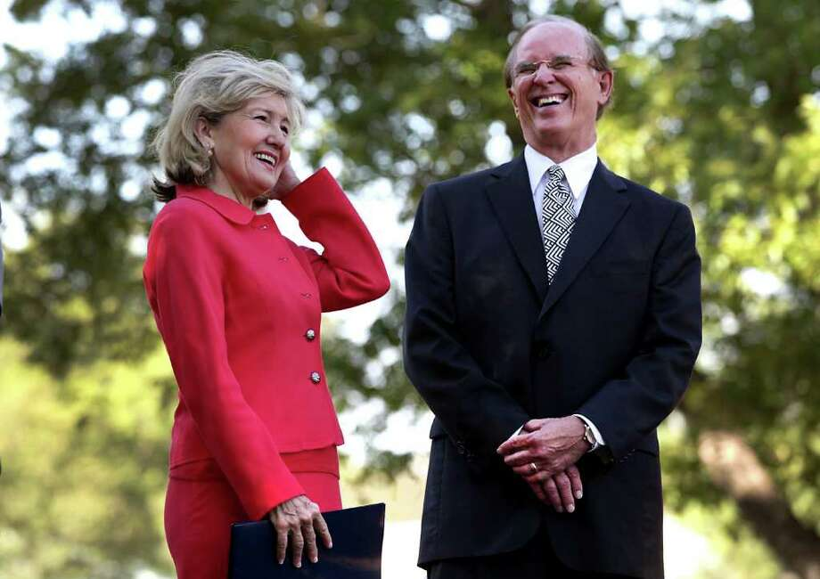 Sen. Kay Bailey Hutchison, left, shares a laugh with Bexar County Judge Nelson Wolff as dignitaries gather at Mission San Juan for the official re-opening of the water flow in the acequia, which the National Park Service, and other agencies, made happen during a 20-year project. Photo: BOB OWEN, Bob Owen/rowen@express-news.net / rowen@express-news.net