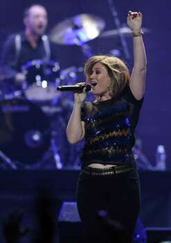 Kelly Clarkson performs during the iHeartRadio music festival on Friday, Sept. 23, 2011, in Las Vegas. Photo: Chris Pizzello, AP