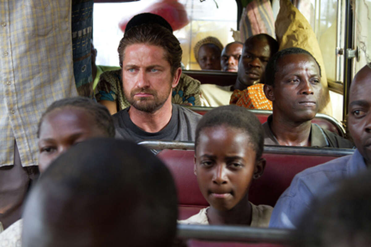 (L-R) Gerard Butler as Sam Childers and Souleymane Sy Savane as Deng in