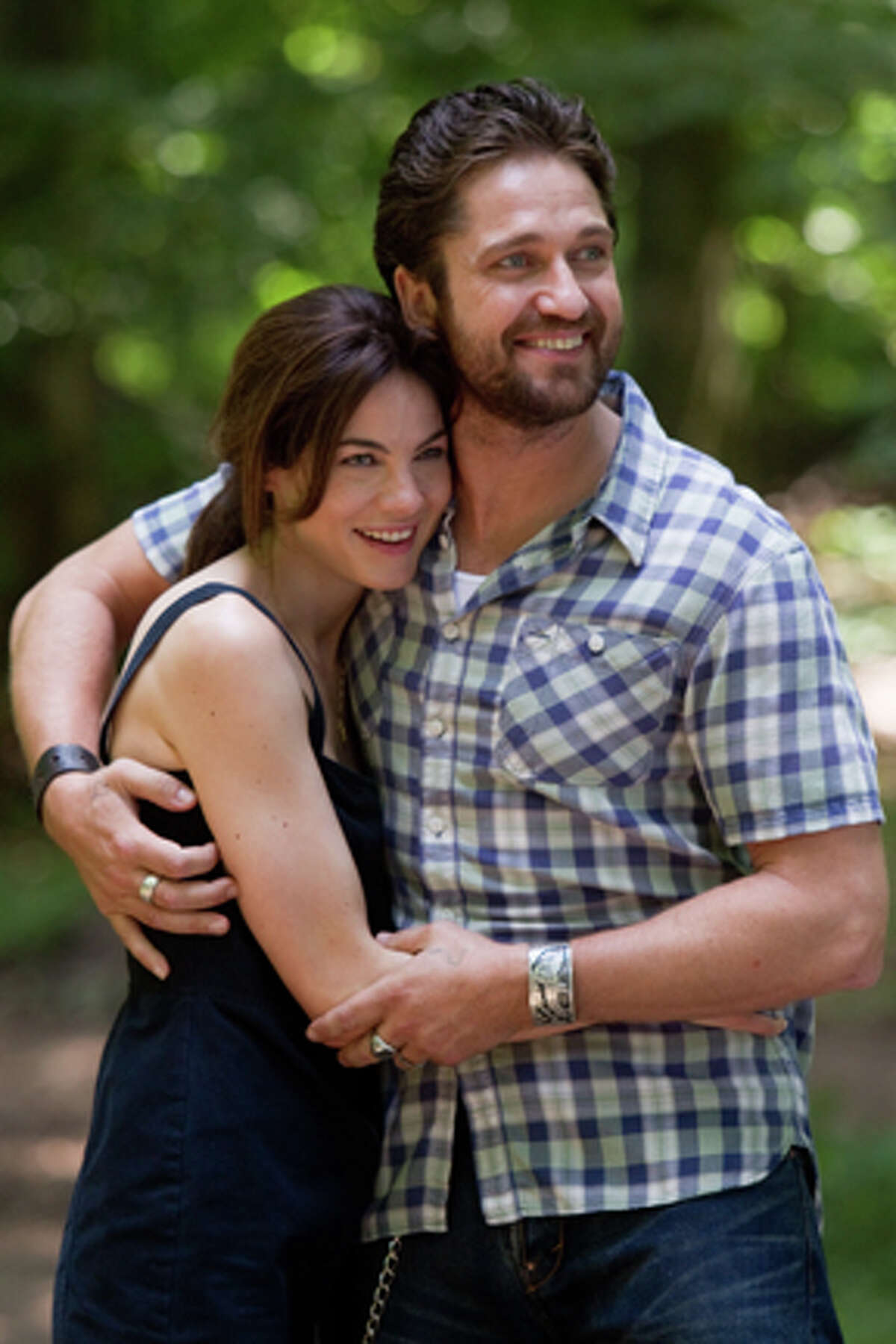 Michelle Monaghan as Lynn and Gerard Butler as Sam Childers in