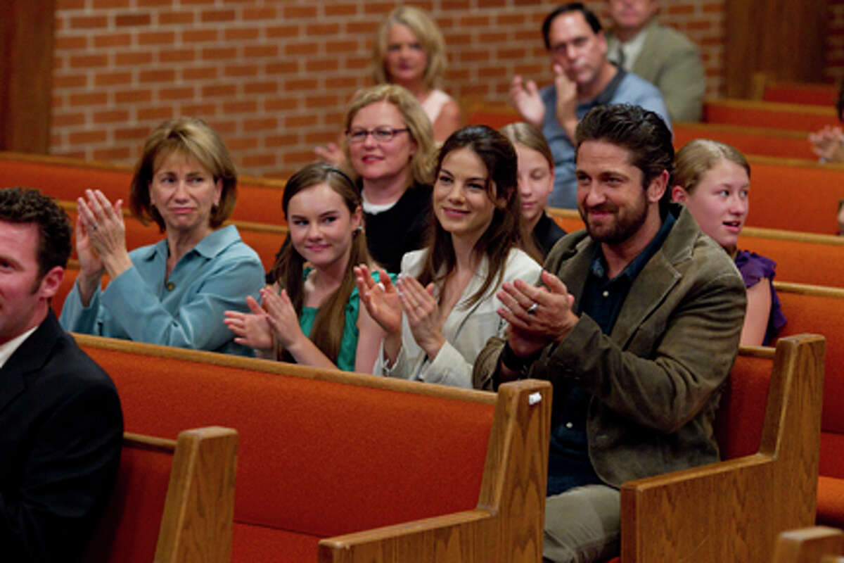 (L-R) Kathy Baker, Madeline Carroll as Saram Michelle Monaghan as Lynn and Gerard Butler as Sam Childers in