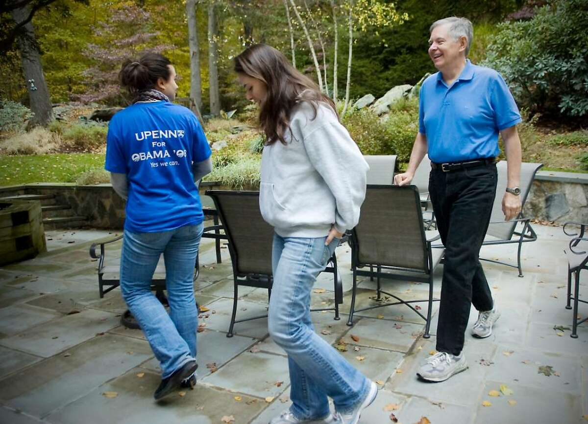 David Martin, Stamford Democratic mayoral candidate, spends a moment at home with his two daughters (L to R) Sarah Martin, 21, and Rachel Martin, 24, on Saturday, October 17, 2009 in Stamford, Conn. Martin is an avid hiker and has taken numerous trips over the years with his daughers.