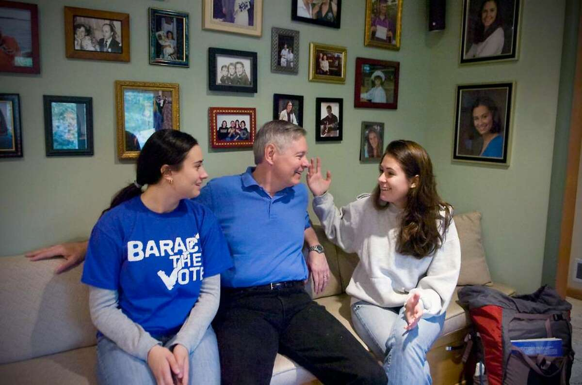 David Martin, Stamford Democratic mayoral candidate, spends a moment at home with his two daughters (L to R) Sarah Martin, 21, and Rachel Martin, 24, on Saturday, October 17, 2009 in Stamford, Conn. Martin is an avid hiker and has taken numerous trips over the years with his daughers. They sit in front of a wall of family photos, many from trips they've taken.