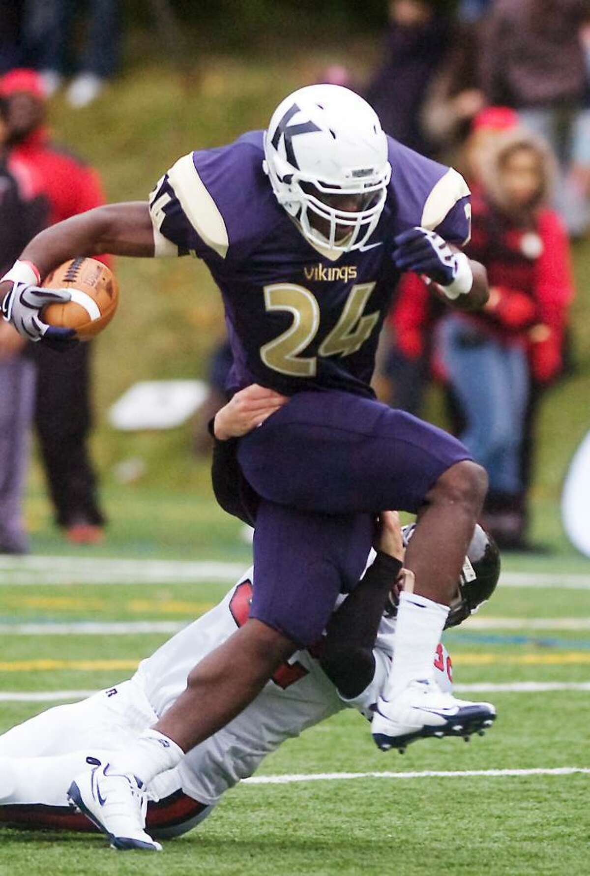 King's Kevin Pierre_Louis slips through the grip of Kingswood-Oxford's Mike Humphreys in football action Saturday, October 17, 2009 in Stamford, Conn.