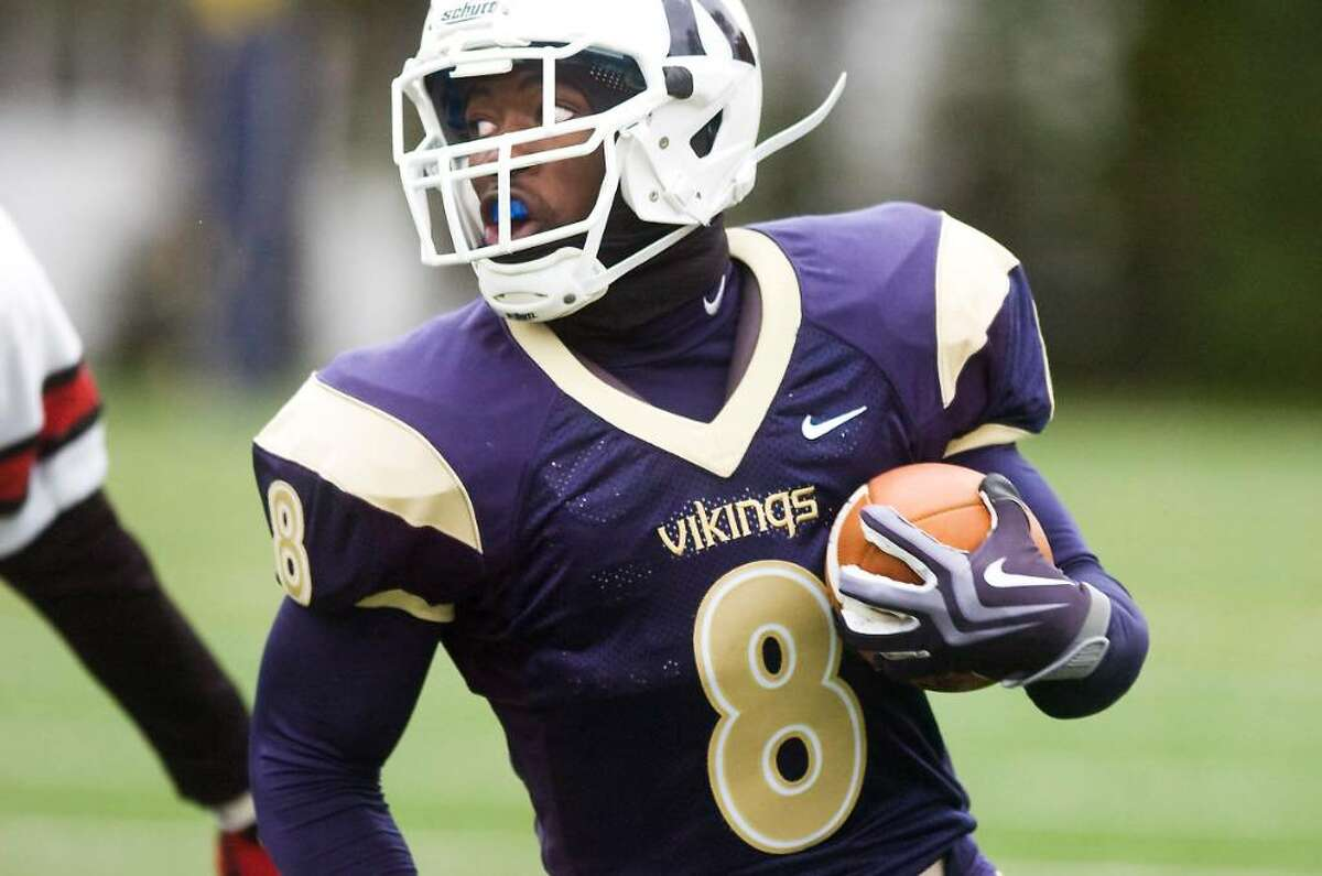 King's Silas Redd carries for a touchdown against Kingswood-Oxford in football action Saturday, October 17, 2009 in Stamford, Conn.
