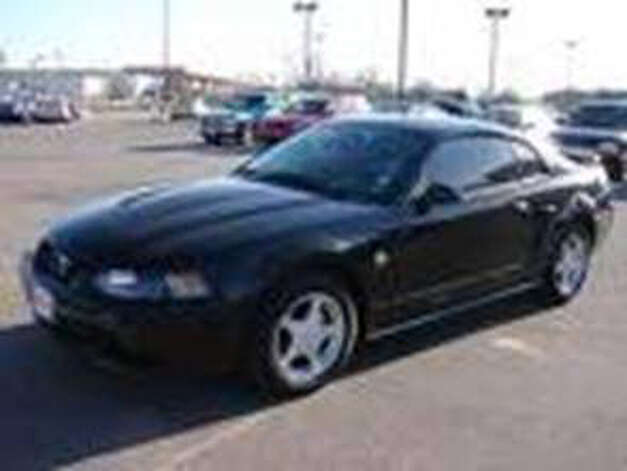 Black Ford Mustang belonging to Matthew Slocum.   (Massachusetts State Police)