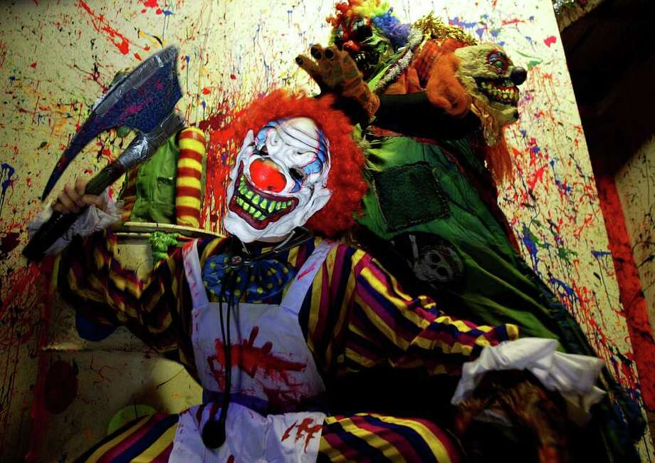 """Actors pose in their clown garb inside Phobia Haunted House's """"3D Clown Phobia"""" attraction described as """"two stories of wack clowns, visually stimulating. Very trippy. Clown dating service available for a nominal fee"""" on Friday, October 20, 2006. (Jessica Kourkounis/For The Chronicle) Photo: Jessica Kourkounis / Freelance"""