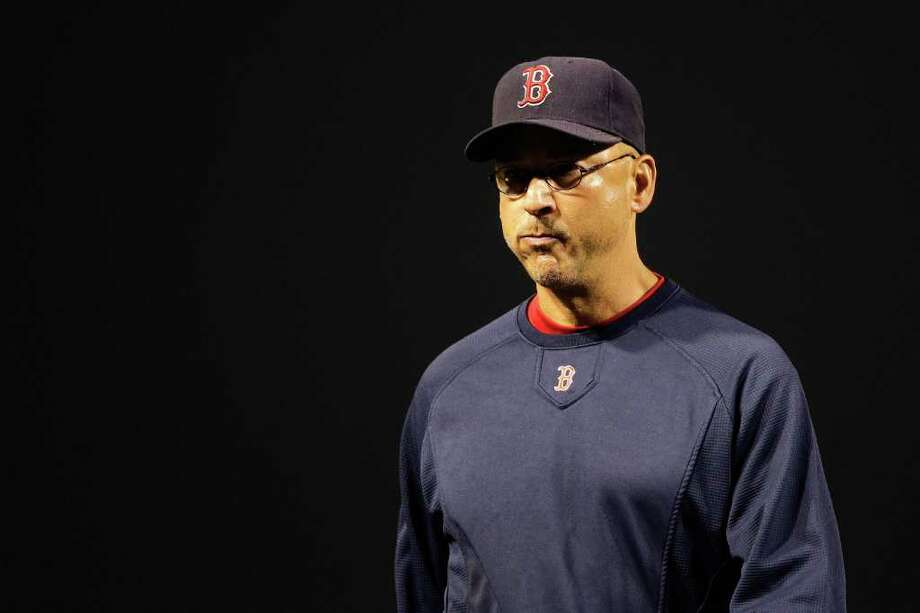 Manager Terry Francona and the Red Sox were 82-51 on Aug. 27 and three games behind the Phillies for the best record in baseball. One month later, they are tied with Tampa Bay for the final wild card spot in the AL. The Red Sox play at Baltimore tonight, and Tampa Bay hosts the Yankees. Photo: Rob Carr, Getty / 2011 Getty Images