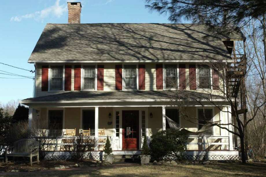 This Colonial house at 124 North Compo Road opened its doors 25 years ago to adolescent girls who were at risk, and over the poasr quarter century has continued to offer shelter, love, guoidance and hope. Photo: Contributed Photo / Westport News