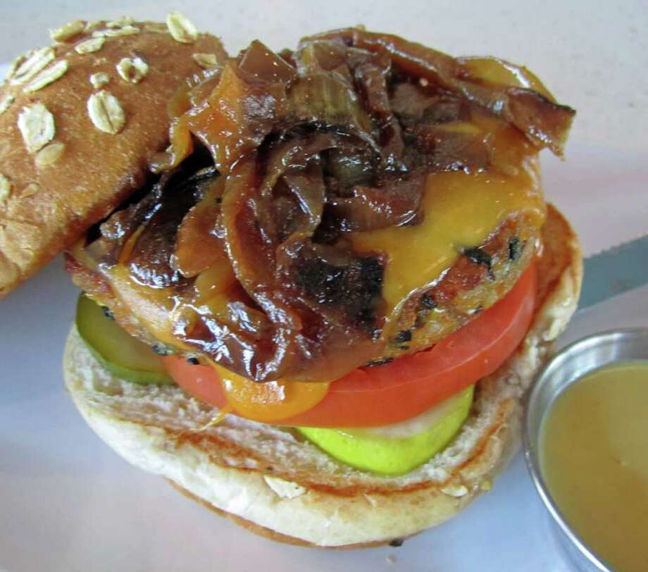 A burger with your burger? Purchase a regular-size burger at the Counter on Saturday and they'll throw in a free mini veggie burger. Photo: Syd Kearney / Houston Chronicle