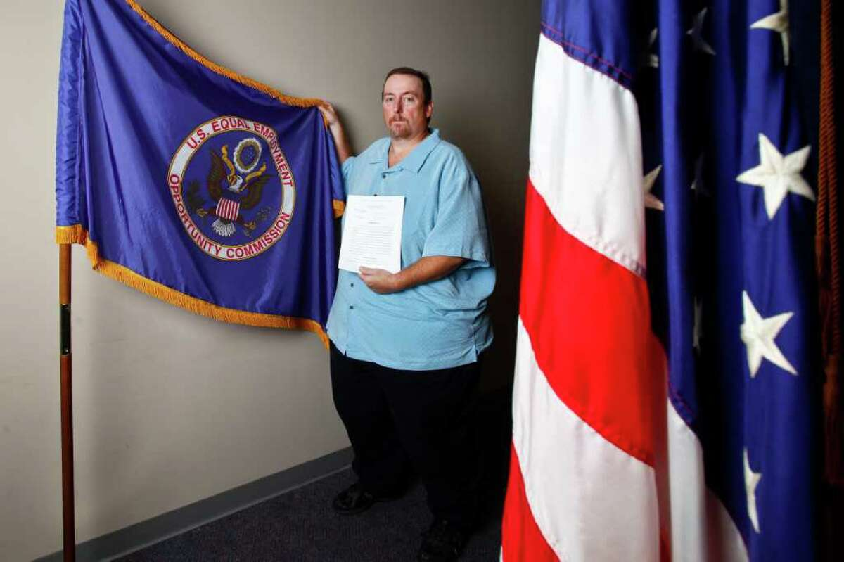 Ronald Kratz II holds a copy of his lawsuit after being fired from his job because his employer, BAE Systems, said he was morbidly obese with a weight of 600 pounds. The Equal Employment Opportunity Commission has sued on his behalf under the Americans with Disabilities Act. Wednesday, Sept. 28, 2011, in Houston. ( Michael Paulsen / Houston Chronicle )