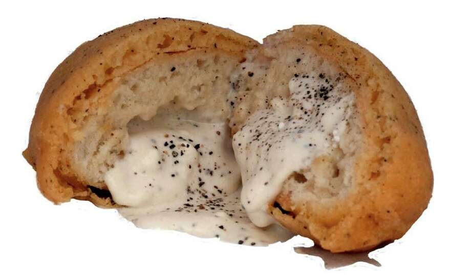 Mark Zable, winner of the 2010 State Fair of Texas Big Tex Choice Award for Most Creative fair food, is entering deep-fried biscuits and gravy for 2011 competition. Photo: Mark Zable