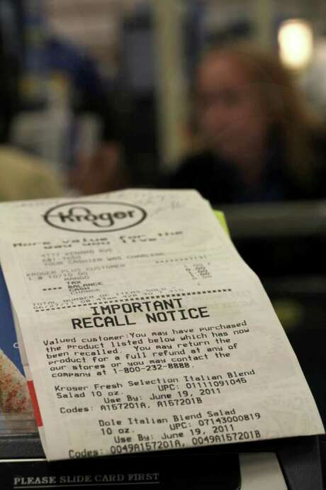 In this June 27, 2011 photo, a Kroger store receipt with a food recall notice on it sits near a check out lane at a Cincinnati Kroger. The products being recalled include Kroger-brand ground beef; Butcher?s Brand beef and generic label beef, which were all produced Aug. 23. Tyson Fresh Meats Inc. is recalling about 131,300 pounds of ground beef that might be contaminated with E. coli, the U.S. Department of Agriculture reported Wednesday, Sept. 28, 2011. (AP Photo/Tom Uhlman) Photo: Tom Uhlman / FR31154 AP
